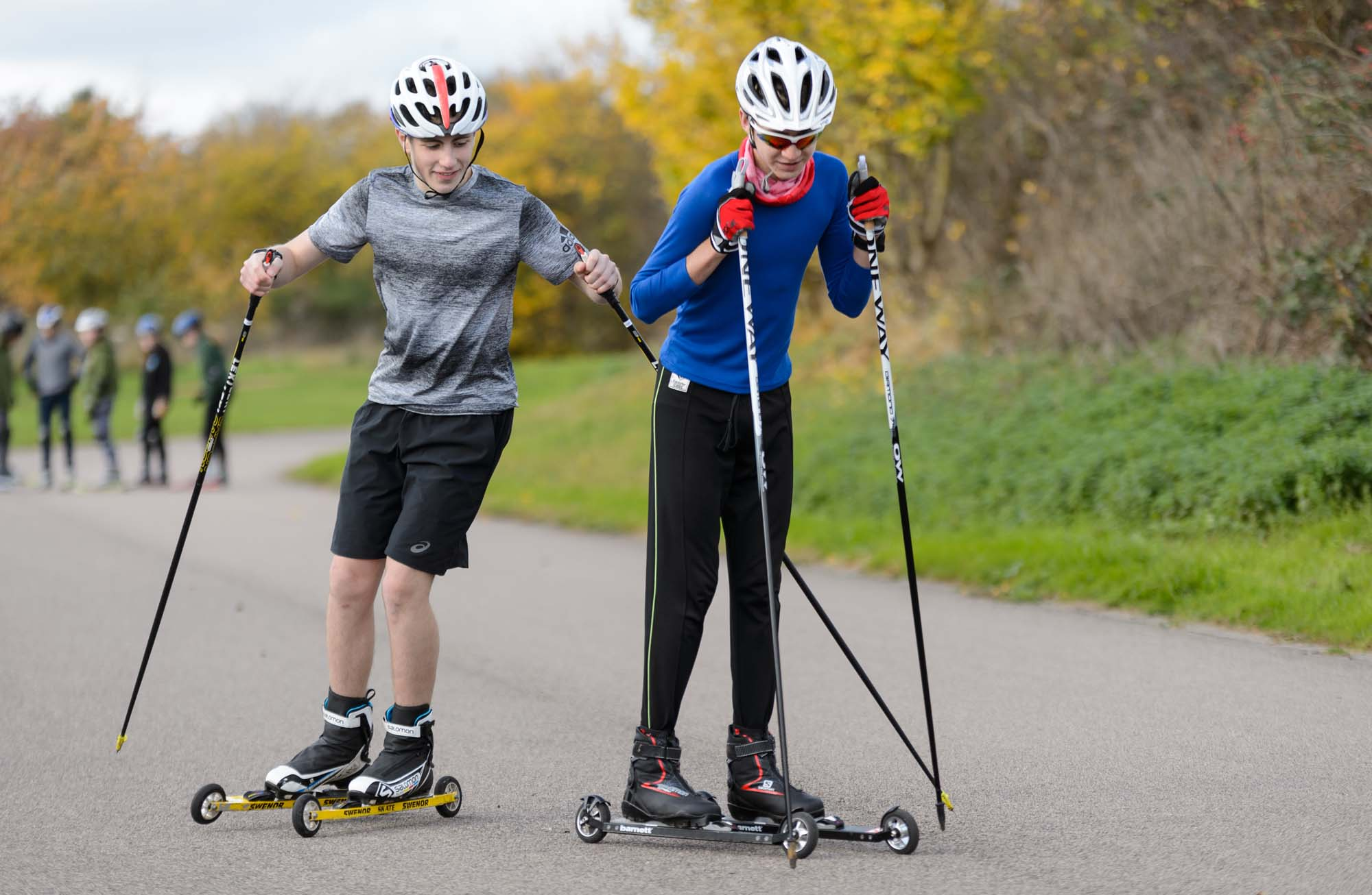 Two teenage boys train in nordic skiing