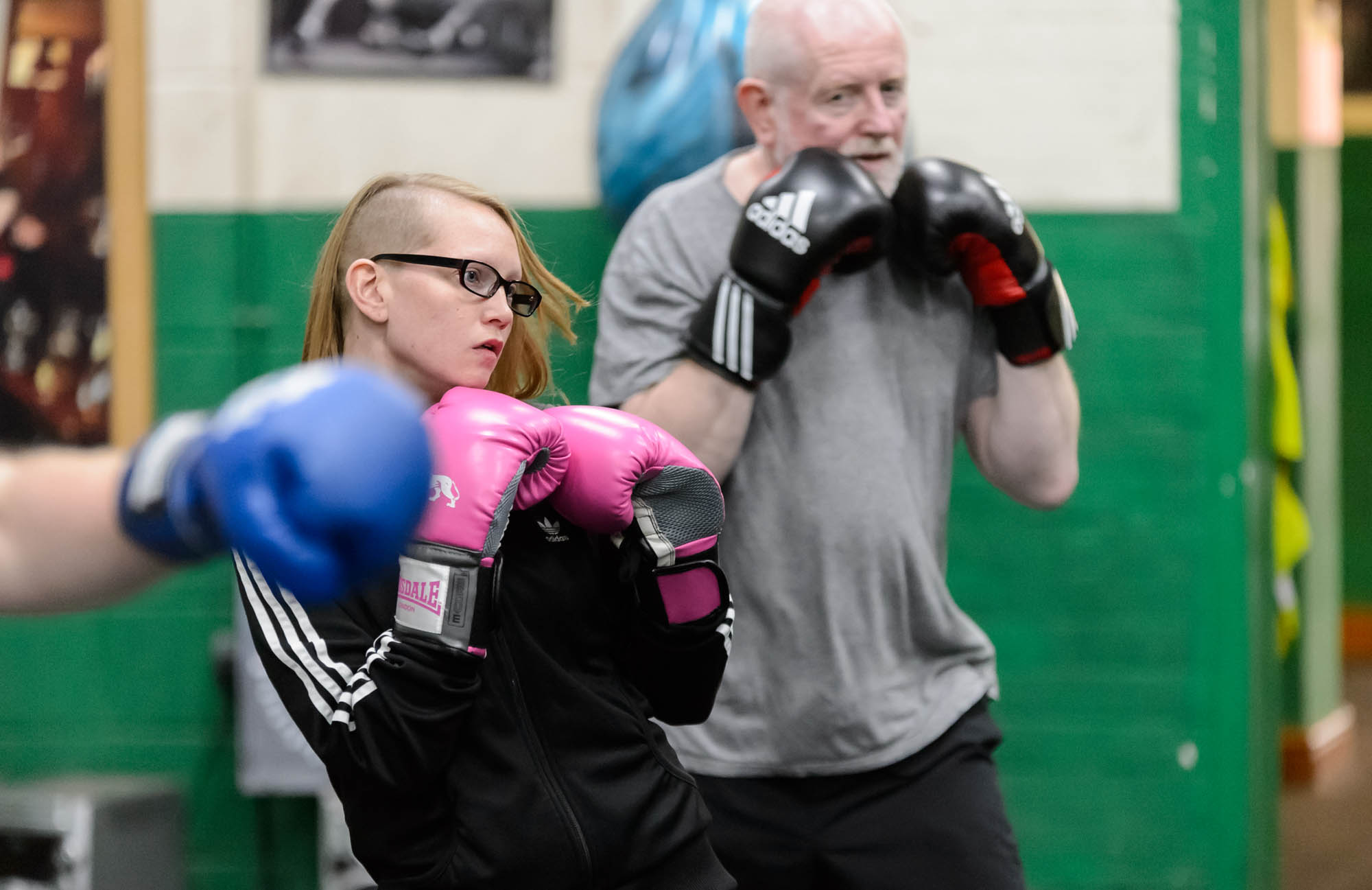 A young woman ducks and dives in boxing training