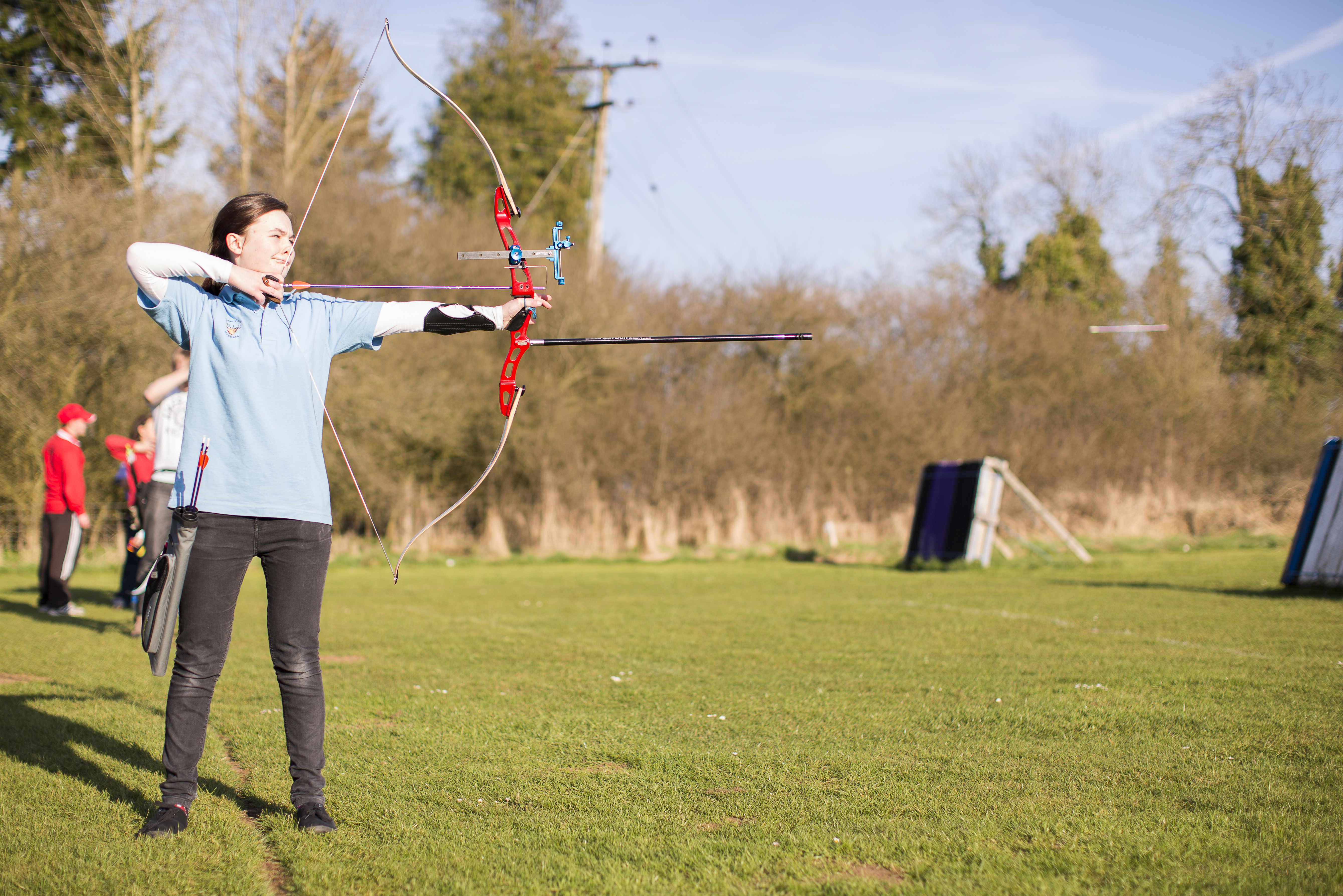 Archery practice girl blue t-shirt 2