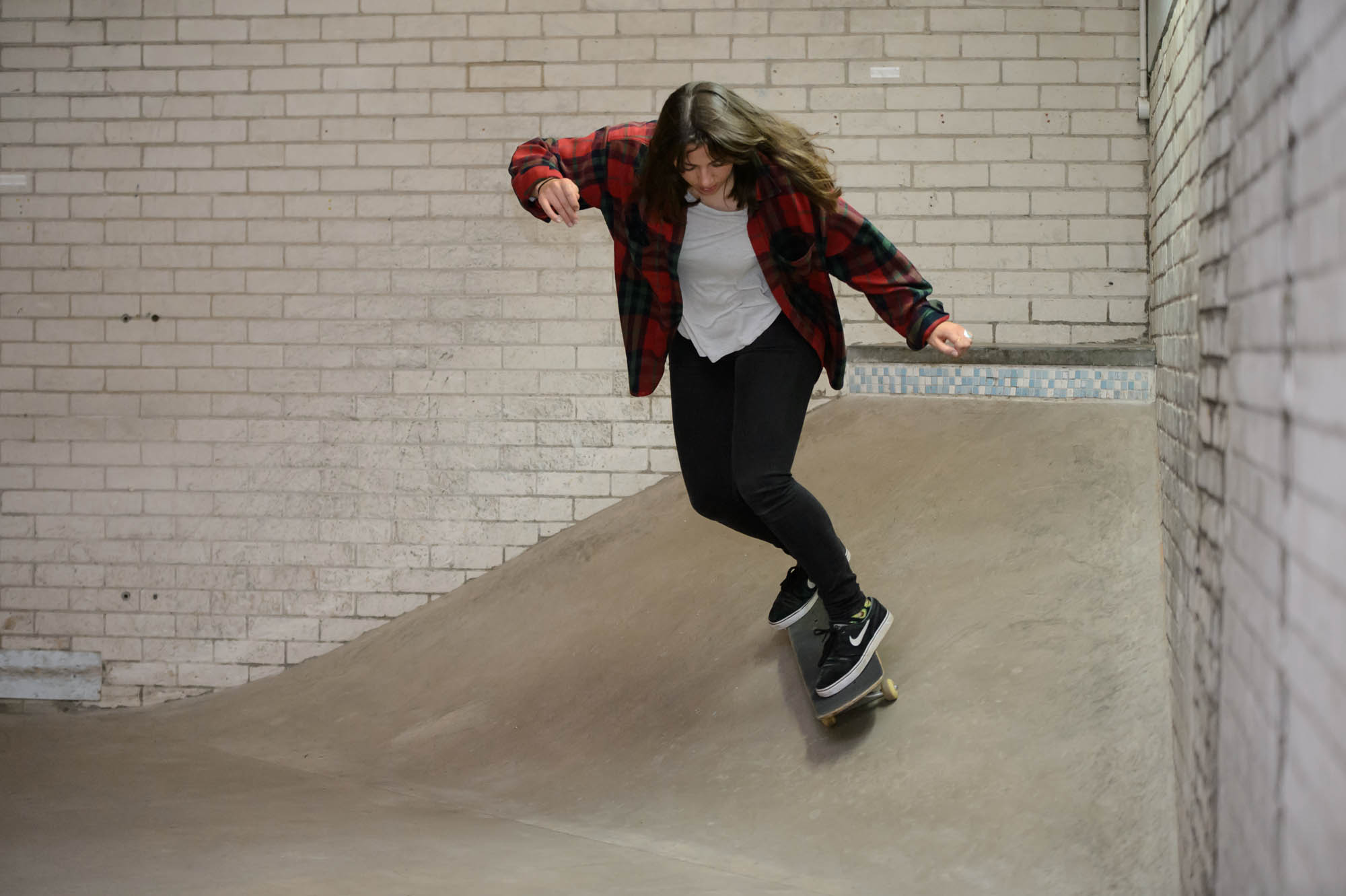 a young woman skateboarding