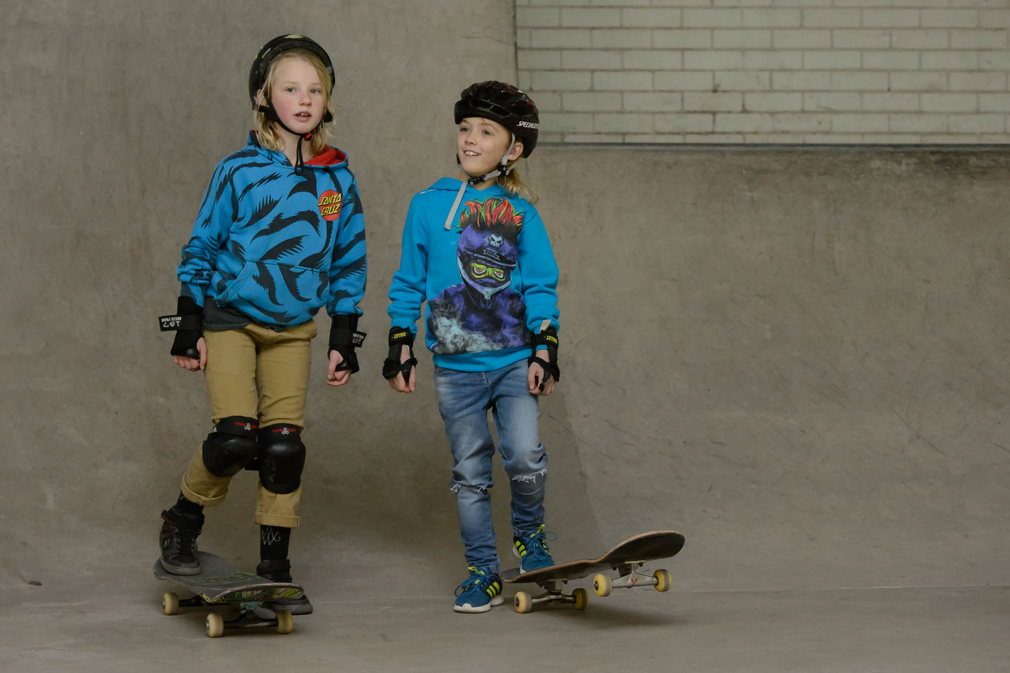 Two young girls on skateboards