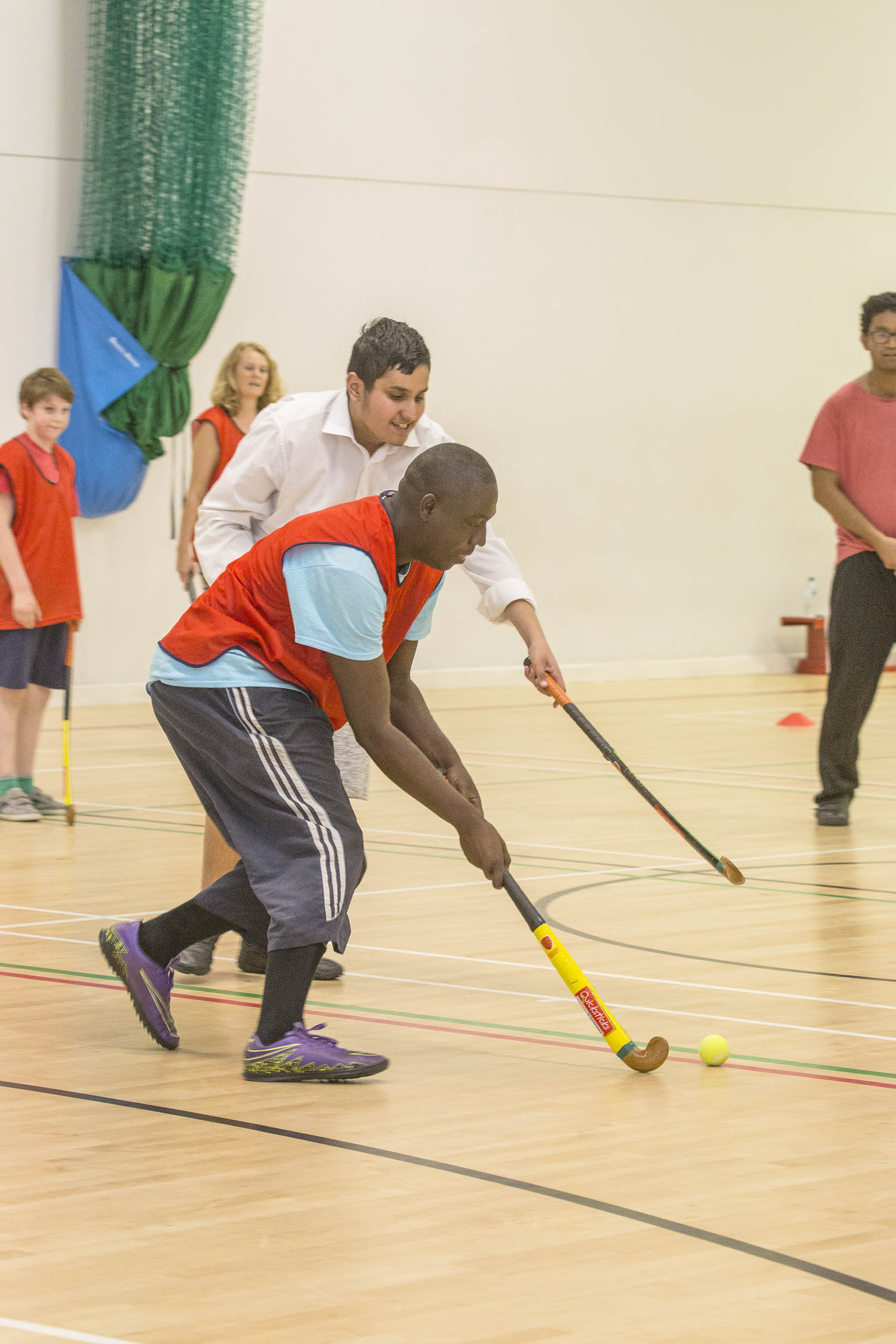 group of people playing indoor hockey