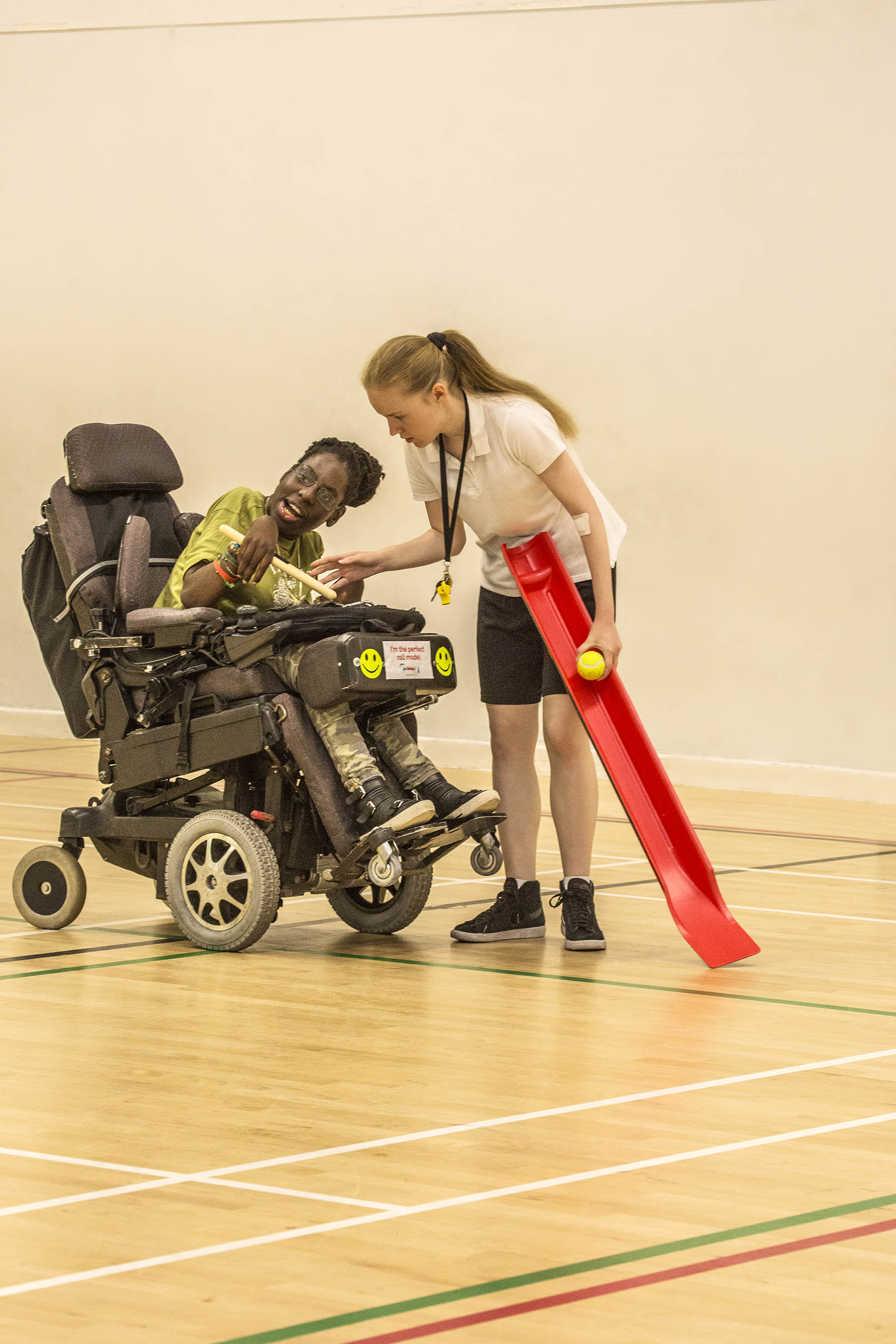 woman in wheelchair with girl instructor