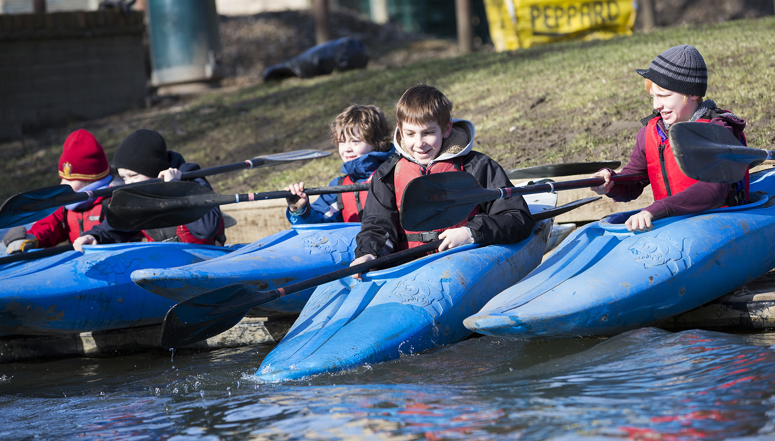 group of children in boats about to go kayaking