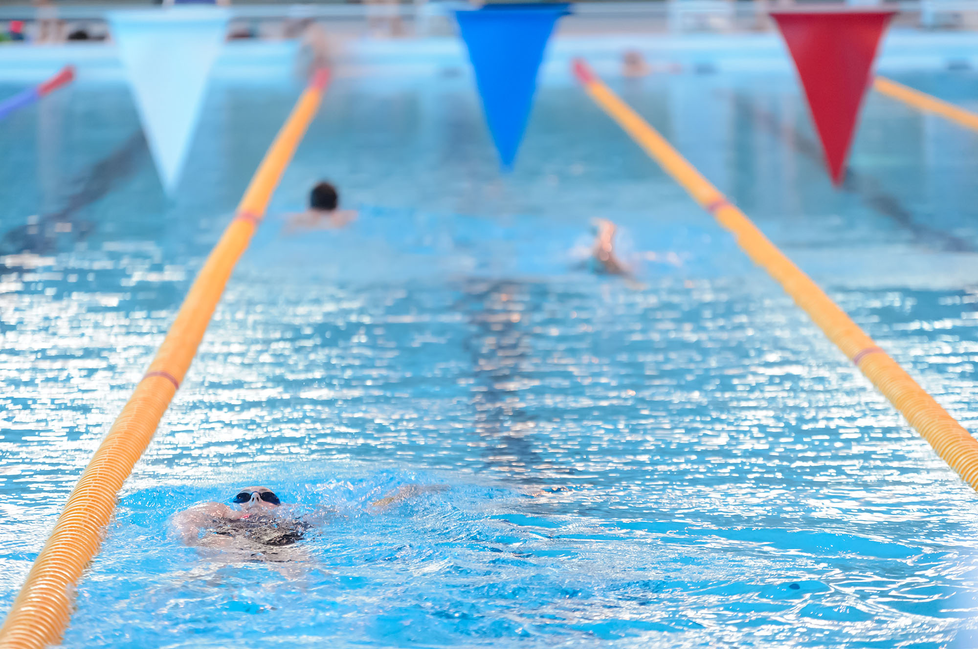 A woman swimming in a lane at the London Aquatics Centre