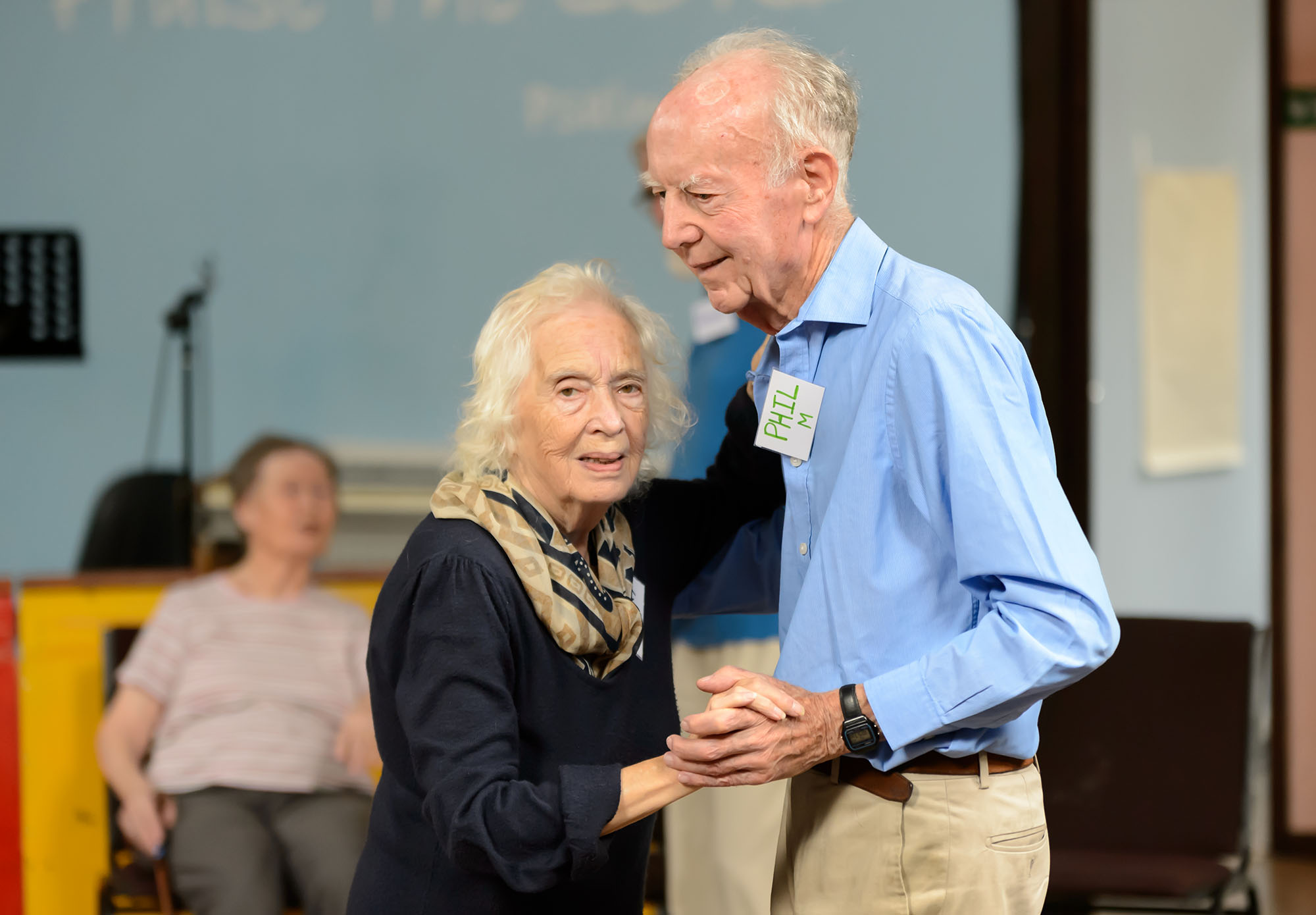 Elderly couple dance at a Love to Move session