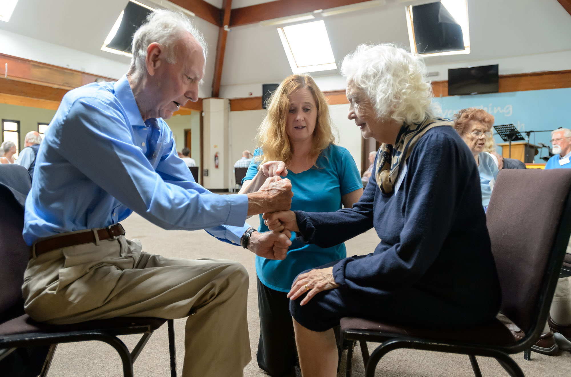 Love to Move instructor helps elderly duo with exercise