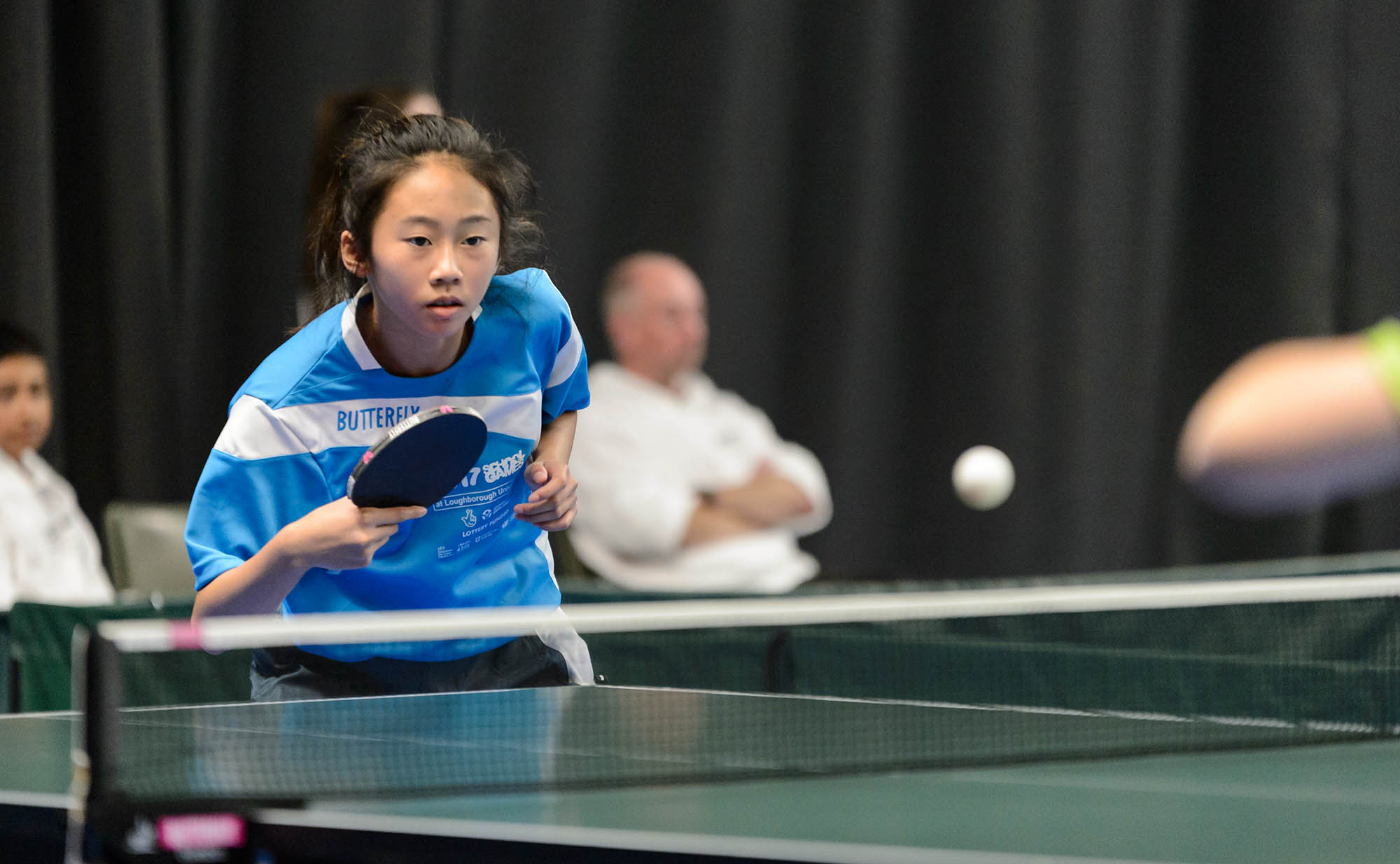 close-up of girl playing table tennis