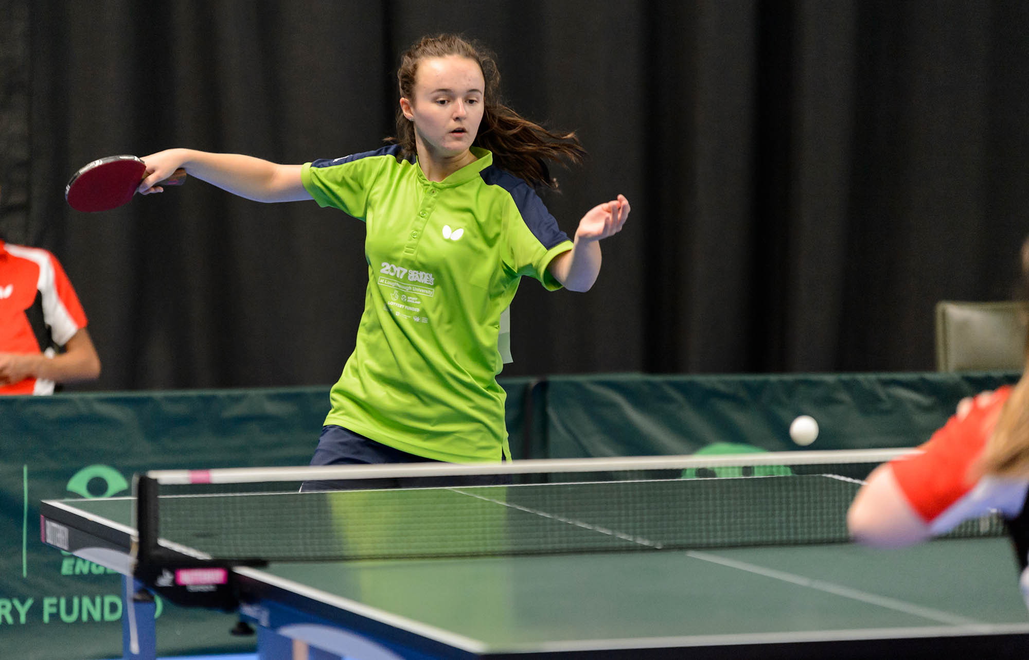 girl playing forehand table tennis action