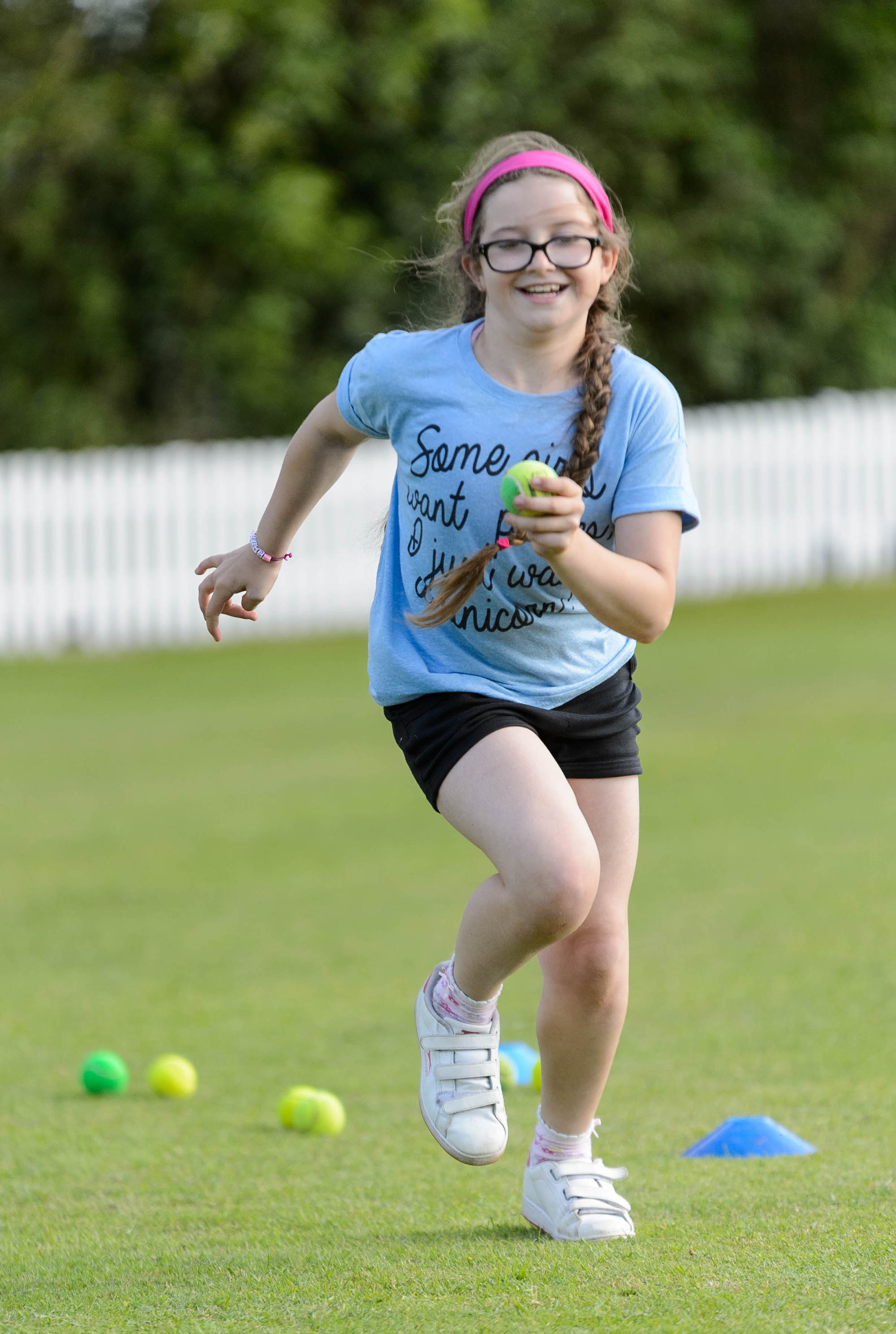girl running with ball in hand