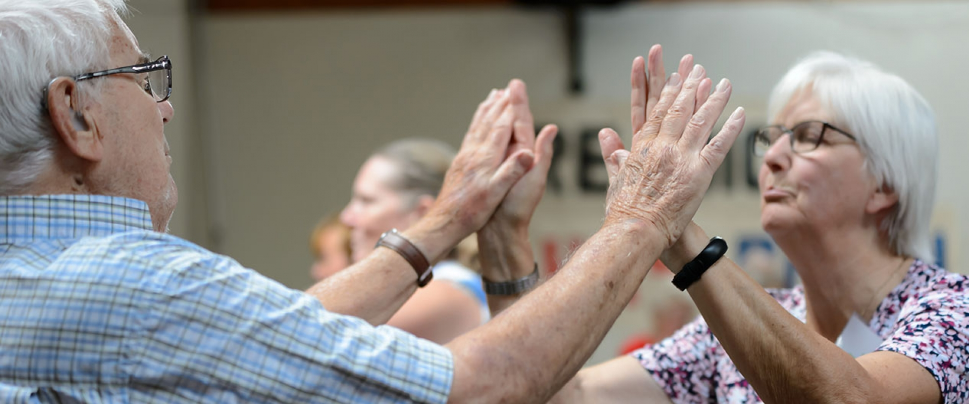 Two pensioners clap hands during a British Gymnastics Love to Move session.