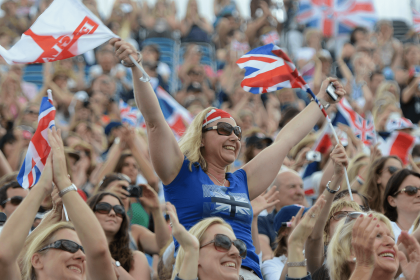 Audience cheering waving England flag