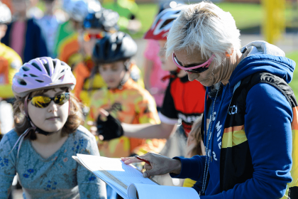 children signing up to a cycling event