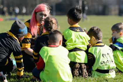Rugby players have team huddle