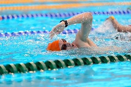 A man swimming at the London Aquatics Centre.