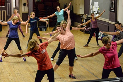 A group of women taking part in a health and exercise class.