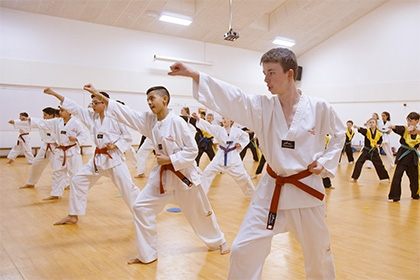 Children are put through their paces at a taekwondo club