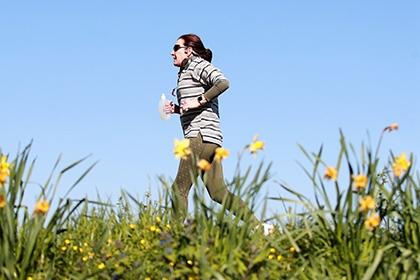 A runner jogs through the park