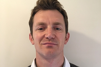 Headshot of Sport England's development manager for coaching, Sion Kitson