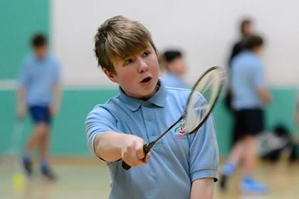 A boy playing badminton