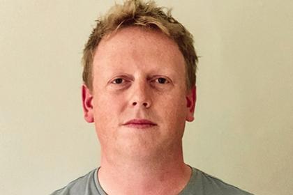 Headshot of James Watmough