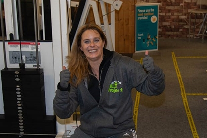 A member of The Billy Project poses for a photo at the gym