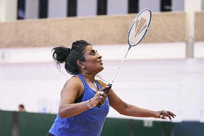 A woman playing badminton
