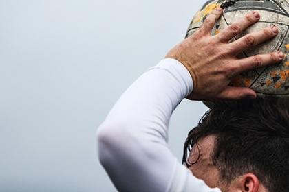 A footballer prepares to take a throw in