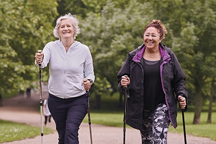 Two women going for a walk in the park