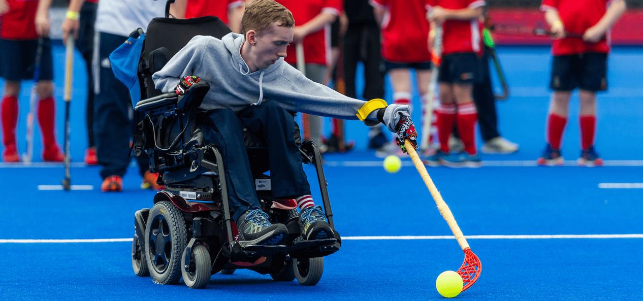 Boy in wheelchair playing hockey