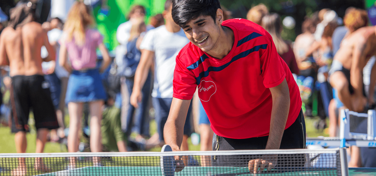 boy playing table tennis at the net