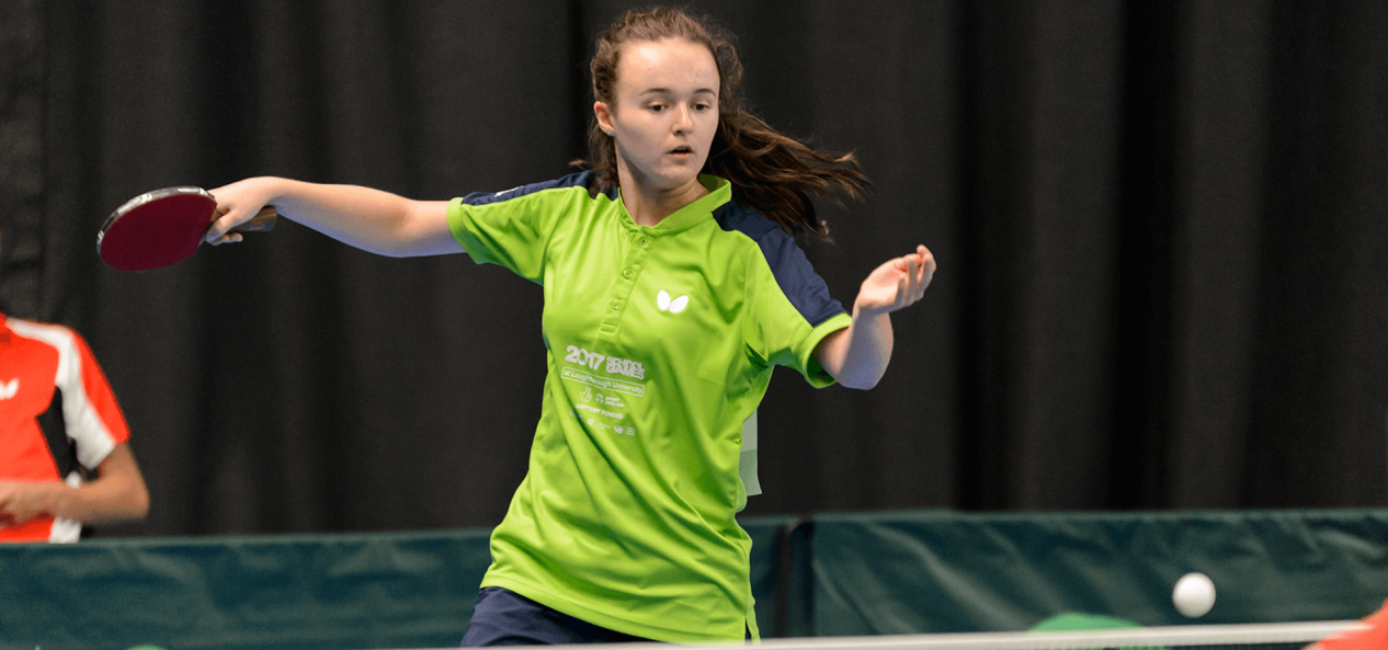 Girl playing indoor table tennis