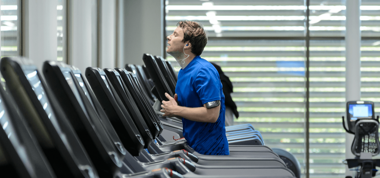 Man running on treadmill in gym