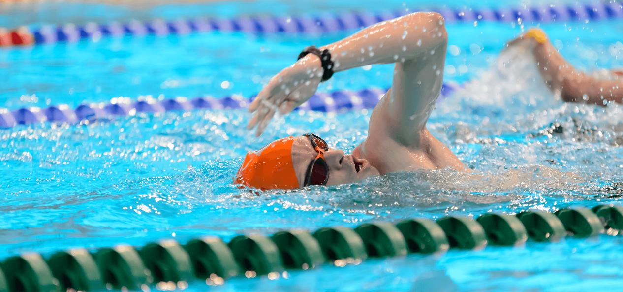 Man swimming in London Aquatics Centre
