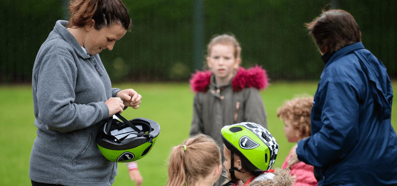 Safeguarding helping with bike helmet
