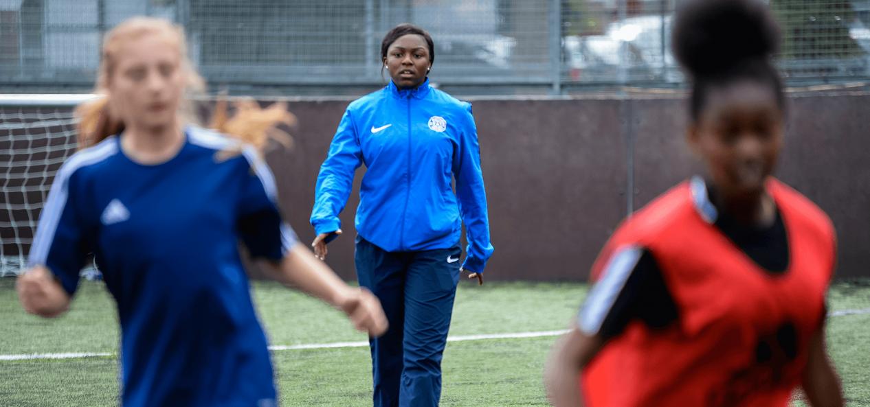 Volunteering football coaching facing camera