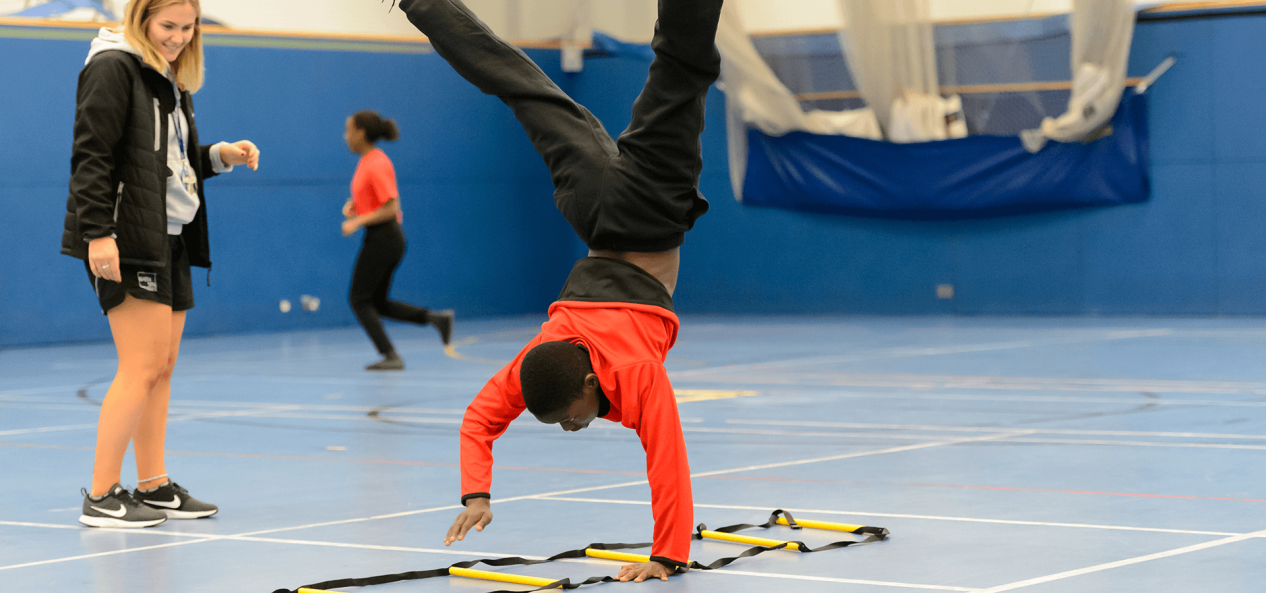 Walking handstand in the gym