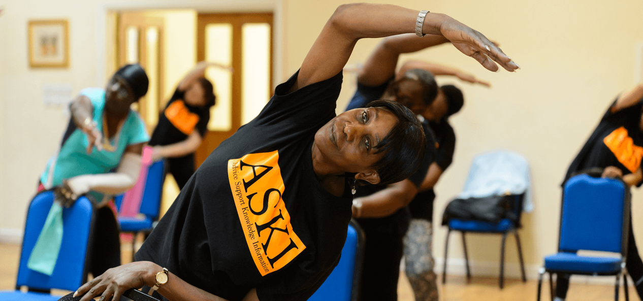 Woman stretching at exercise class