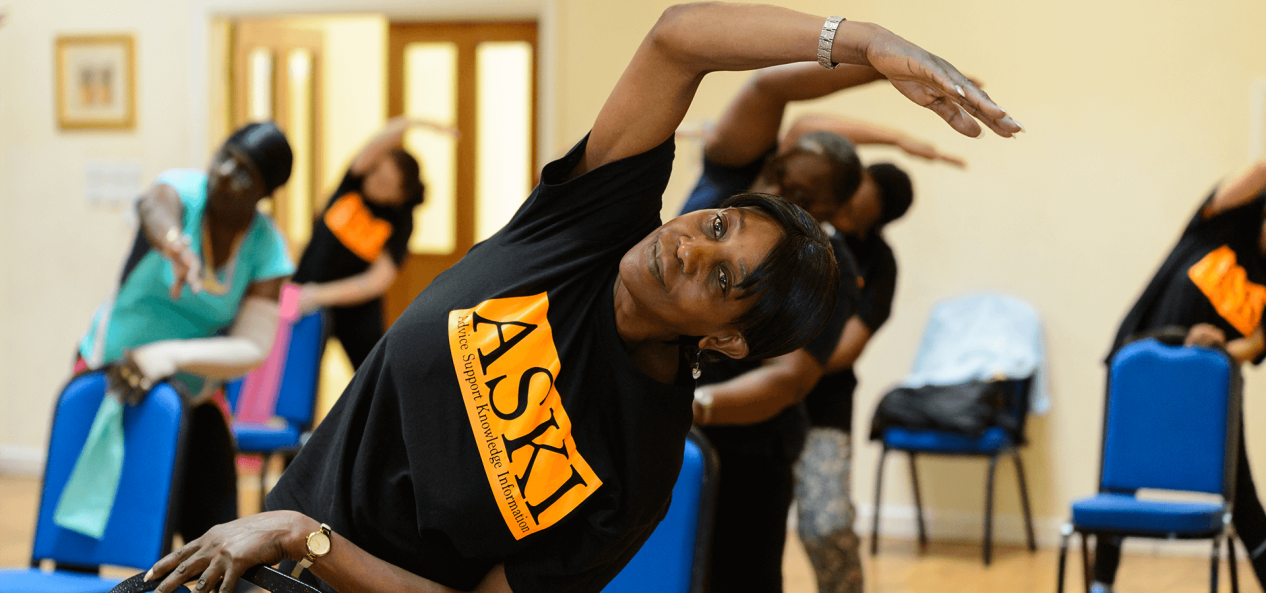 Woman stretching in group class