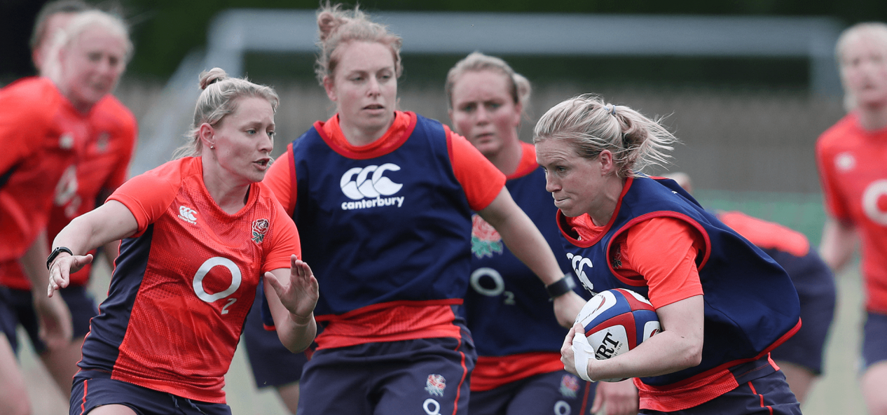 Women playing rugby outdoors 2