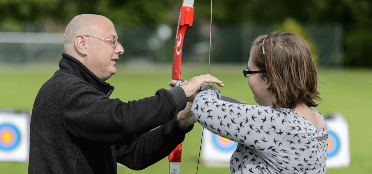 Coaching archery lesson