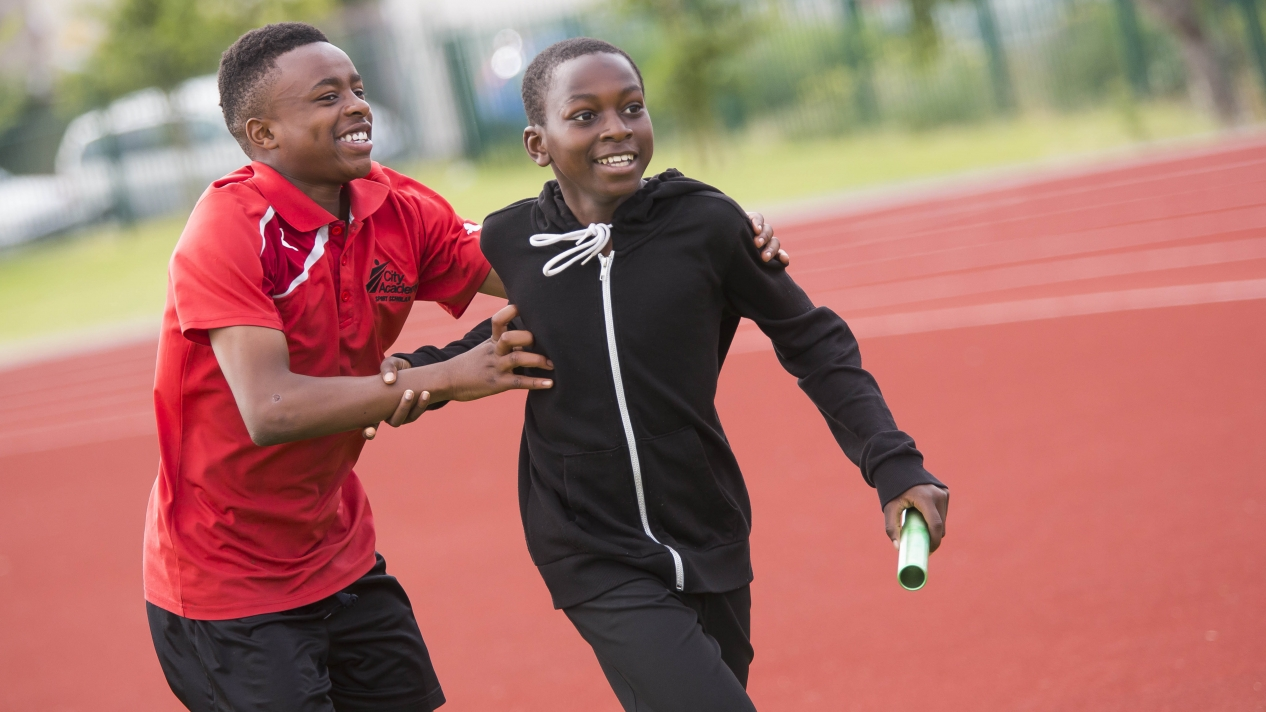 Two boys running a relay