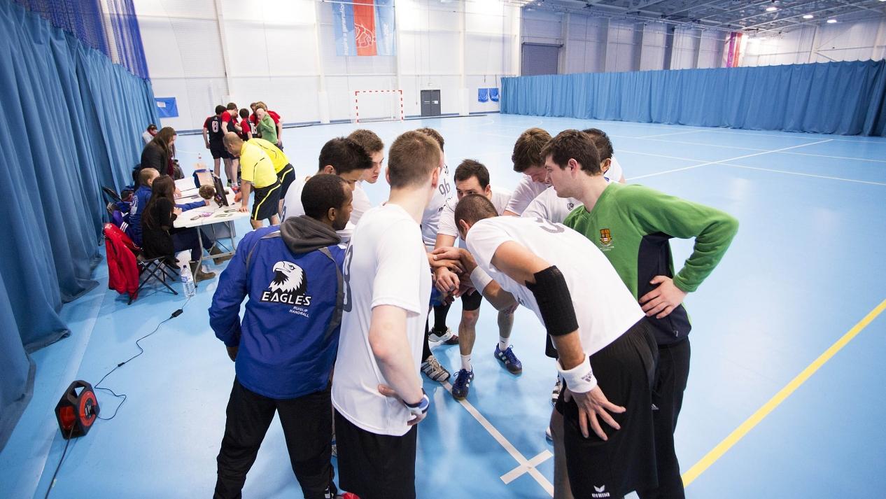 handball players gathered in a circle