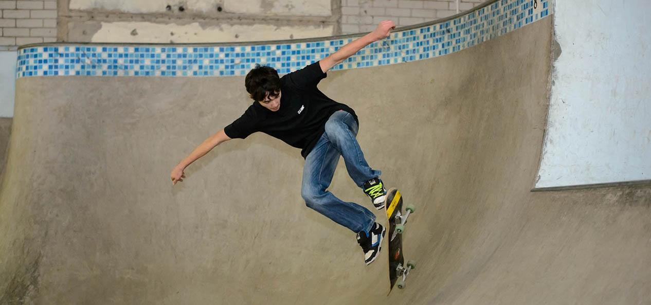 A young man enjoying the skate park