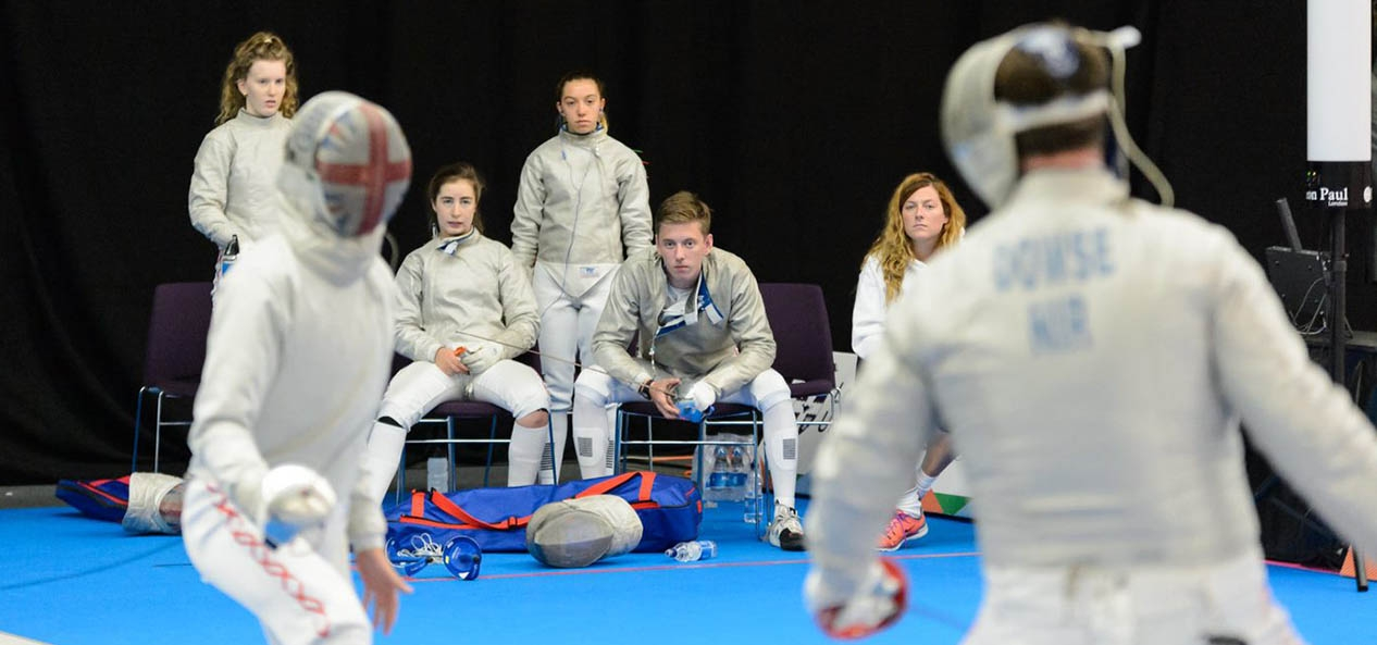 Young fencers watch a contest