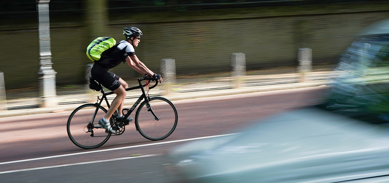A man cycling in a cycle lane.
