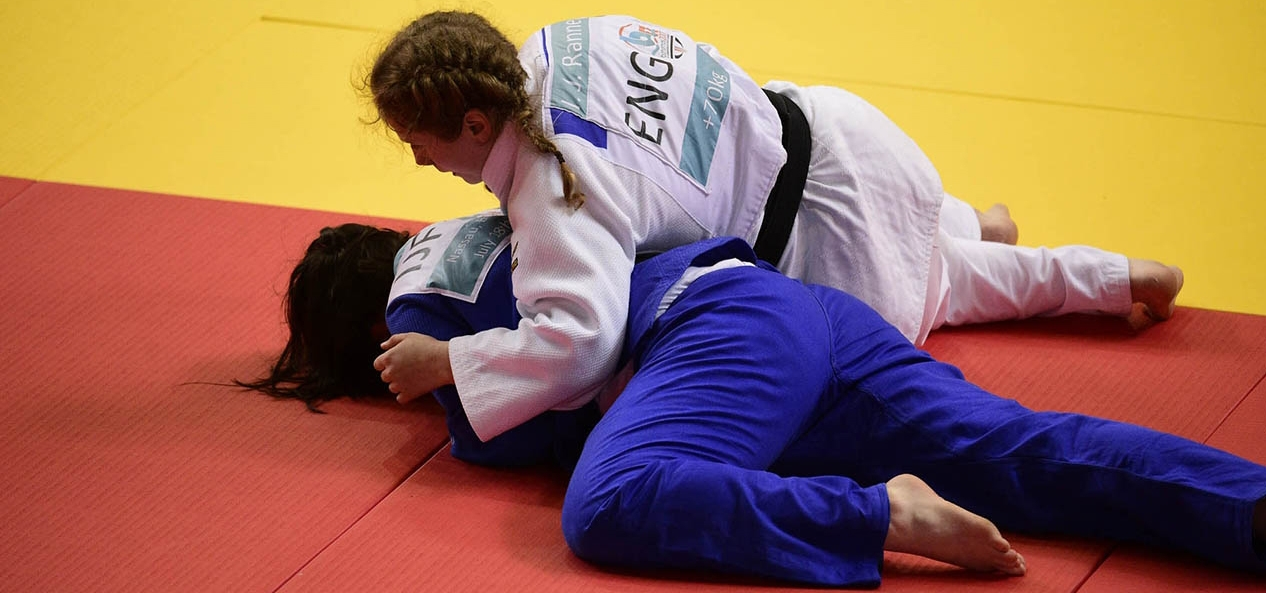 Two young athletes compete at judo