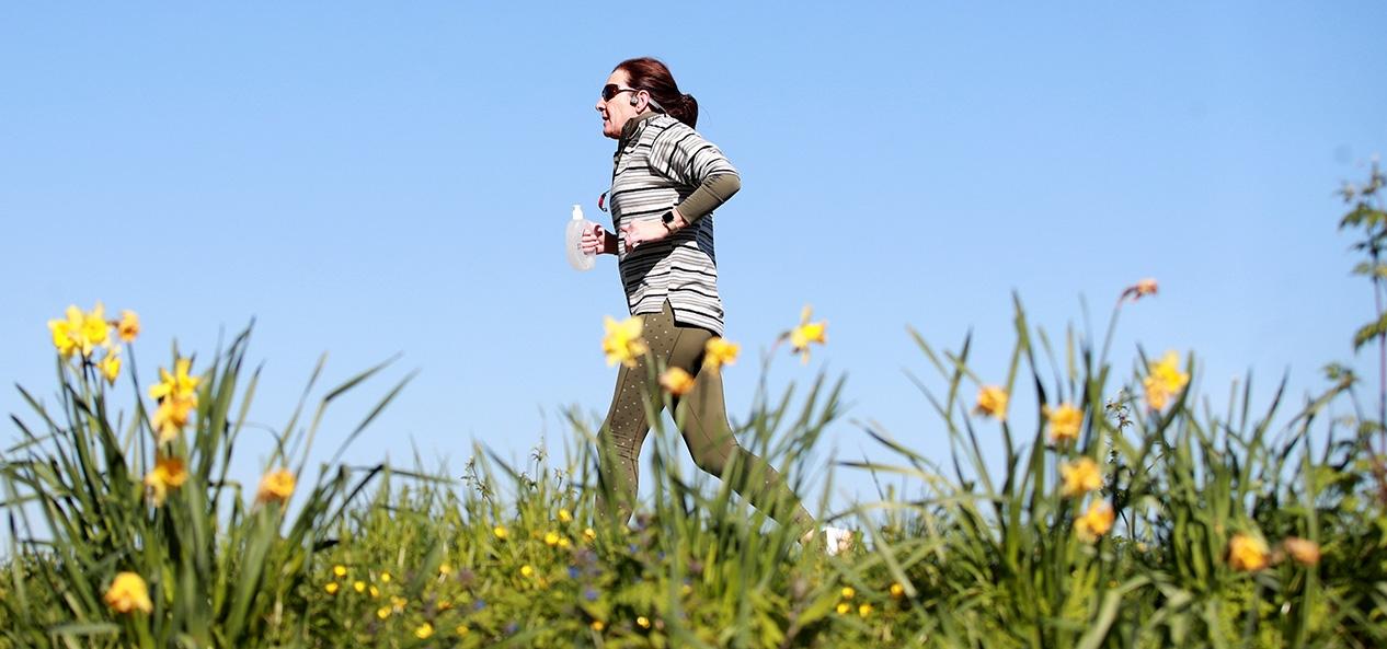 A runner enjoys a run in park
