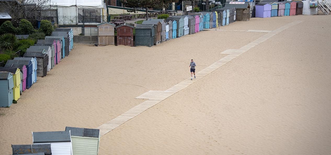 A man runs alone on Broadstairs beach, Kent