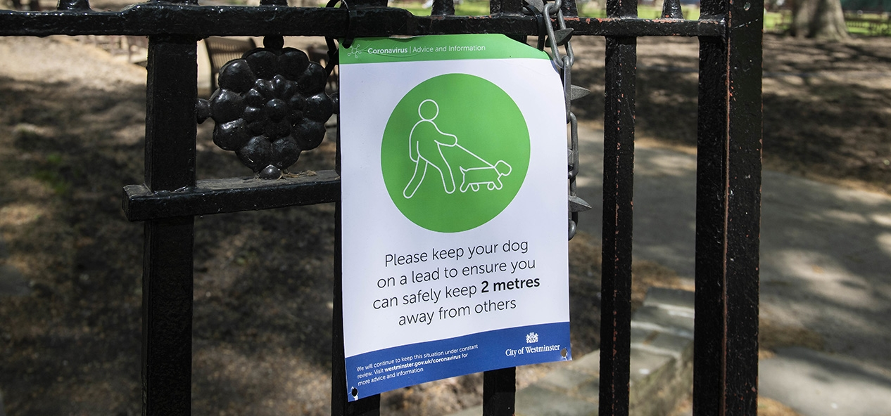 A social distancing sign outside a park in Mayfair, London